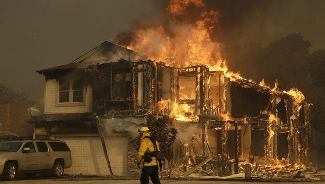 Officials in Santa Rosa, Calif., have had to constantly expand  their area of mandatory evacuations.   Jeff Chiu, AP A firefighters walks near a home in Santa Rosa, Calif., Monday, Oct. 9, 2017. Wildfires whipped by powerful winds swept through Northern California sending residents on a headlong flight to safety through smoke and flames as homes burned. (AP Photo/Jeff Chiu) ORG XMIT: CAJC115