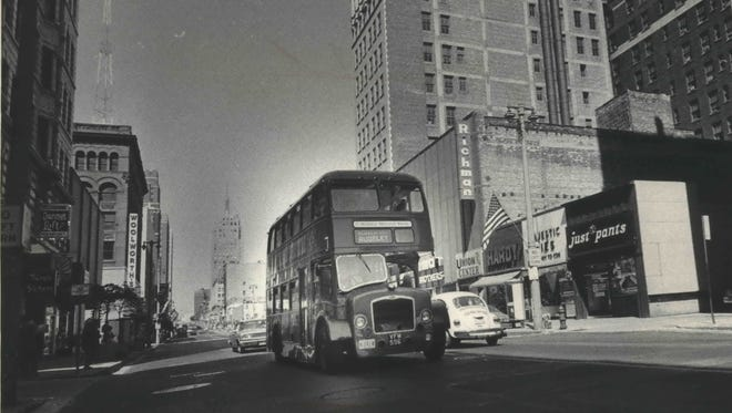 A Midland National Bank double-decker bus cruises down W. Wisconsin Ave. on July 15, 1974, the first day of the free shuttle's service. This photo was published on the front page of the July 15, 1974, Milwaukee Journal.