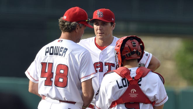 Homer Bailey, center, talks with then-Bats pitching coach Ted Power and catcher Raffy Lopez during a conference on the mound June 27 against Buffalo at Slugger Field.