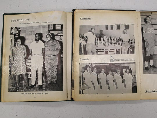 Pages from Merry High School yearbooks are laid open to show Wanda Drake's parents at the NAACP office downtown on Monday. Both of Drake's parents were custodians; Drake's mother is on the far left of the left picture and Drake's father is on the left of the top-middle picture.