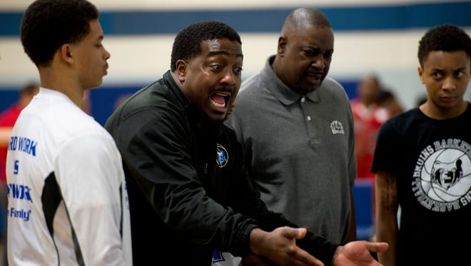 Former Battle Creek Central and Western Michigan University standout Ben Reed (center) has been named the head coach for the Kellogg Community College men's basketball team.