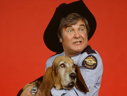 James Best, as Sheriff Roscoe P. Coltrane, his dog, 'Flash' (played by