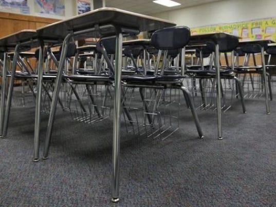 635812378657727887-635695522956361640-EDUCATION-classroom-empty-seats-StarPress