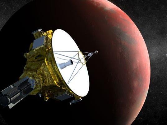 635907265218660894-635567475609791169-New-Horizons-spacecraft-.jpg