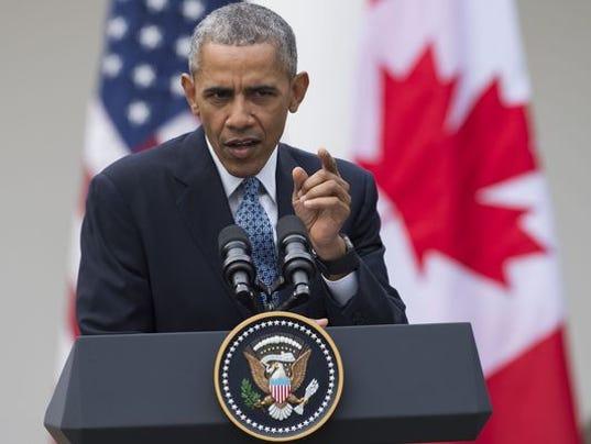 635933177513856014-635932767401701785-Obama-podium-Canada.jpg