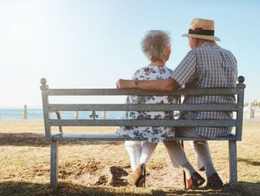 636489698679531805-elderly-senior-couple-sitting-on-a-bench-on-the-beach-large.jpg