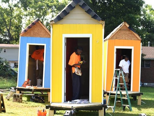 Homeless man jumps for joy over new tiny house for Small house design village