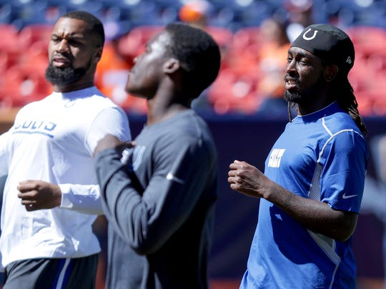 Indianapolis Colts wide receiver T.Y. Hilton (13) and other receivers warm up before facing off against the Denver Broncos at Sports Authority Field at Mile High in Denver on Sunday, September 18, 2016.