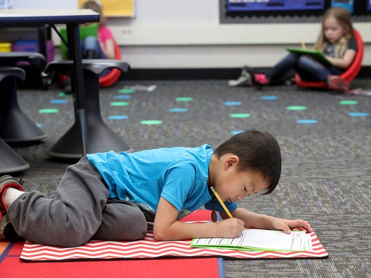 Lassen View Elementary School kindergartner Kano Xiong, 5, works on his assignment Wednesday at the school in Redding.