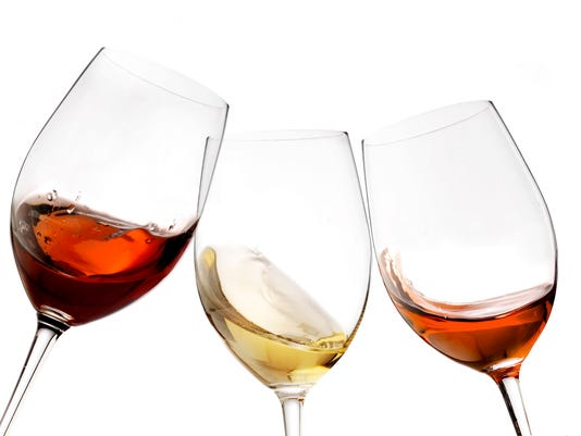 red and white wine with splash, cheers close up  isolated