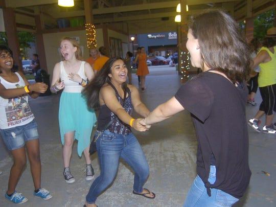 Nami Patel (left) and Laila Krijestorac have a blast on the dance floor.