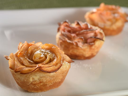 Apple Rose Tarts are made with apple slices and purchased puff pastry dough.