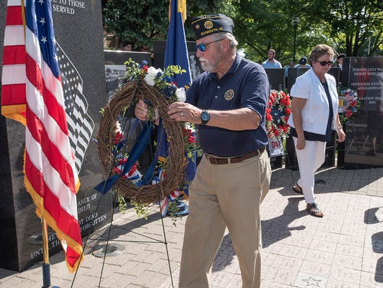 Laying Memorial Day wreaths.