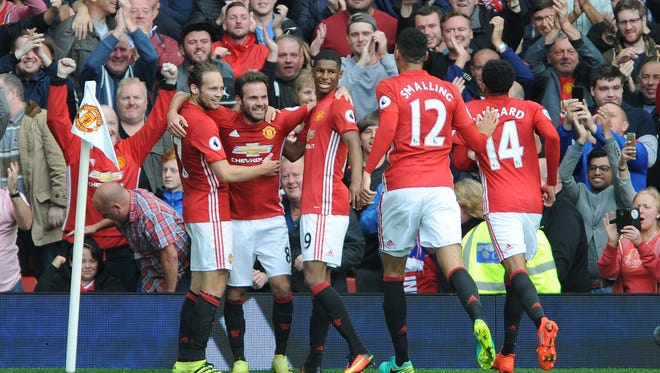 Manchester United's Juan Mata, second from left, celebrates his goal with teammates.