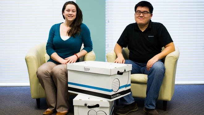 Alissa Fagan and Gihoon Song of Marbles LLC, from left to right, pose with products at the office in Bonita Springs on Thursday, Dec. 10. Marbles LLC specializes in technical research, applied ergonomics and human factors, and market-focused design.