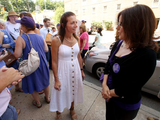"""Tammy Snyder Murphy, l, wife of NJ Gubernatorial candidate Phil Murphy, speaks with Saily Avelenda of NJ 11th for Change, attending the weekly """"Fridays with Frelinghuysen"""" rally"""