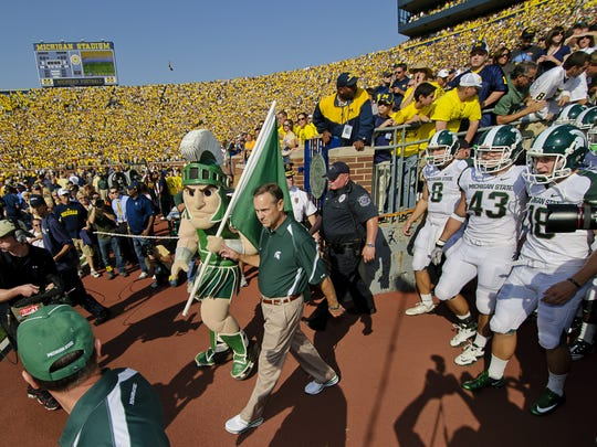 MSU Football Head Coach Mark Dantonio leads his team out of the tunnel prior to their game with Michigan Saturday October 9, 2010 in Ann Arbor.  KEVIN W. FOWLER PHOTO