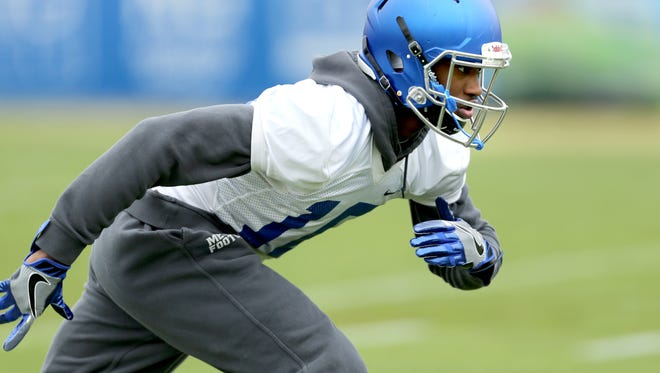 Memphis wide receiver Damonte Coxie runs drills during practice.