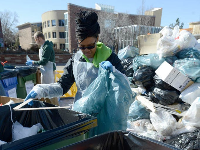 Charmaine Parish, a senior at CSU, goes through a trash bag during the waste audit on the CSU campus Wednesday, March 5, 2014.  The annual Waste Audit occurs during RecycleMania and is held as part of CSU'??s Housing & Dining Services efforts to reduce waste. RecycleMania is a friendly inter-collegiate competition that encourages students to recycle more. The Waste Audit is part of the competition and helps to further educate the campus community.