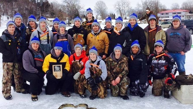 The members of the Ledger Fishing Club pose with their winning plaque and some of their catch.