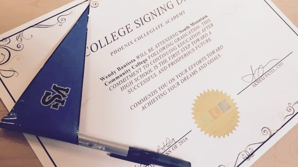 The seniors at Phoenix Collegiate Academy each signed certificates of intent to the colleges they would attend.