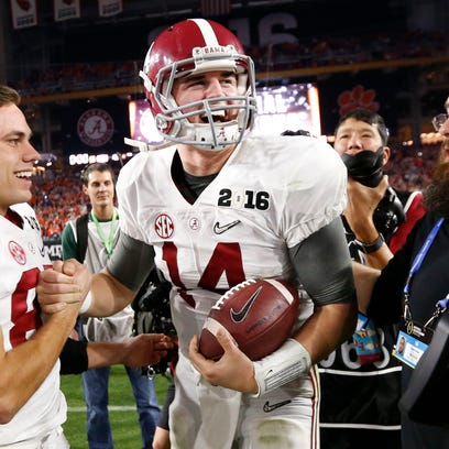 Alabama QB Jake Coker (right) celebrates with WR Parker
