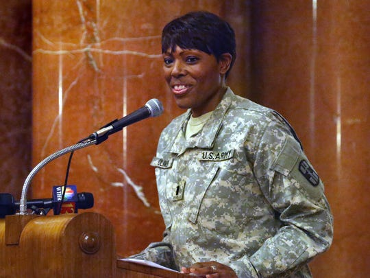 1st Lt. Tyra Oliver, deploying commander for the U.S. Army Reserves 55th Combat Operational Stress Control (medical) detachment stationed at Fort Benjamin Harrison in Lawrence, speaks at the deployment ceremony at the Indiana War Memorial in Indianapolis on Saturday, August 2, 2014. The unit will be providing basic psychological and wellness assistance for deploying and returning soldiers and civilians in Kuwait in support of Operation Enduring Freedom.