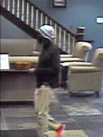A man donning a fake beard and a fishing hat robbed a bank at 2:11 p.m. July 9 at Byline Bank, 13925 W. North Avenue.