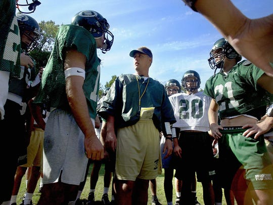 September 27, 2000 - Briarcrest coach Hugh Freeze meets with players during practice Wednesday afternoon as they prepare for their showdown with ECS Friday.