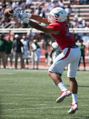Delaware State's Myles Beverly (33) reaches for the