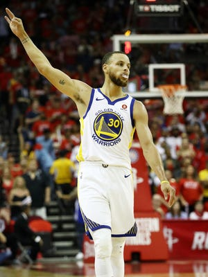 Stephen Curry of the Golden State Warriors celebrates a three-pointer in the third quarter of Game 7.