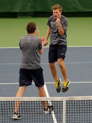 Xavier's David Horak celebrates with Konnor Barth after winning on match point in a Division 2 doubles semifinal at the WIAA boys tennis state tournament at Nielsen Tennis Stadium on Saturday in Madison.  Adam Wesley/USA TODAY NETWORK-Wisconsin