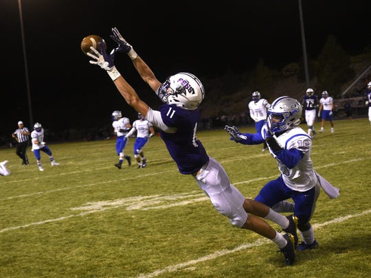 Spanish Springs' Jordan Dudick (11) tries to make a catch against McQueen during their football game at Spanish Springs on Sept. 29