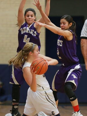 Coronado's Meagan Bean looks to pass to a teammate as Burges defenders Kayla Galindo, left, and Becca Cardenas defend Tuesday.