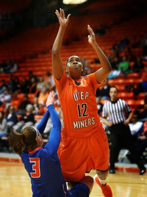 UTEP's Sparkle Taylor, right, put up a shot after colliding with Houston Baptist's Heidi Sihvola during the first quarter Sunday. Taylor was called for a foul on the play.