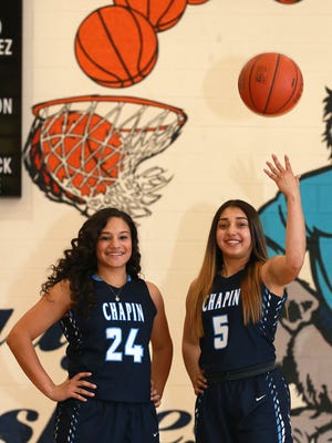 Aolanis Jusino-Acosta, left, and Kiana Vega have been instrumental in the Chapin Huskies' success this year.