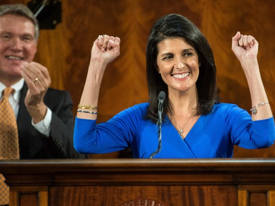 South Carolina Gov. Nikki Haley raises her fists to