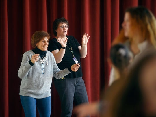Lincoln Intermediate Unit education interpreters Rosemary DiCesare and Hollie Knovich use sign language to help students during an animal-inspired choreography workshop recently at the Appell Center for the Performing Arts.