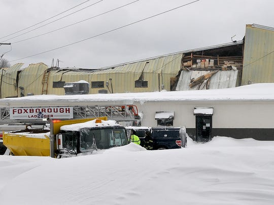 One of two warehouse style buildings at the Foxboro Terminals facility on North Street in Foxboro, Mass. was damaged after the weight of snow on the roof gave way, Sunday, Feb. 15, 2015.