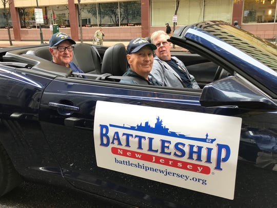 Front seat passenger  Russell Collins of Palmyra rides in the Veterans Day Parade in Philadelphia this year with two other  Battleship New Jersey Museum ahnd Memorial volunteers, Charlie Stewart (left) of Haddonfield and Richard Thrash of Virginia.