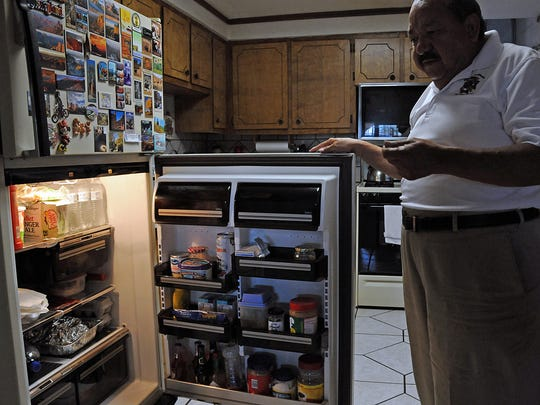 Ramon Sierra keeps bottles of water in the refrigerator