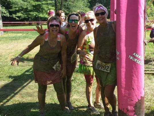 "The ""5K Virgins"" a group of moms near Mason City participate in a mud run together."