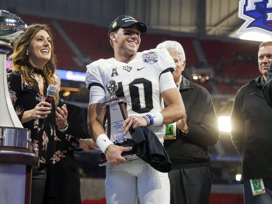 Central Florida quarterback McKenzie Milton celebrates after the Knights defeated Auburn in the Peach Bowl.