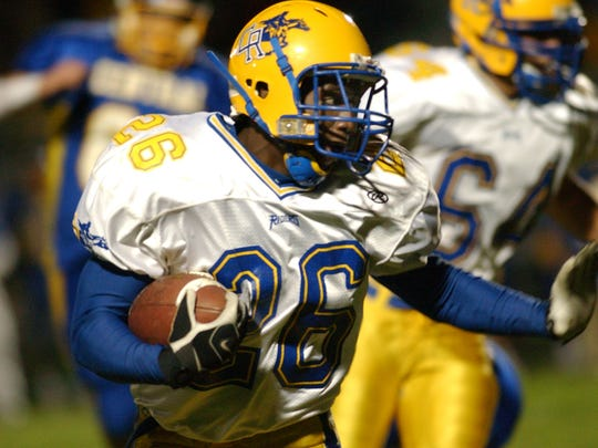 Duron Harmon carries the ball for Caesar Rodney during a 2007 game.