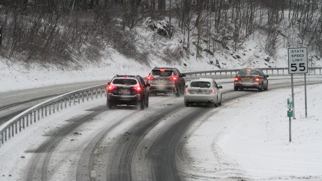 Motorists pass a slow moving car on the Taconic State Parkway in Kent Jan. 9, 2015.