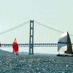 File photo of yachts passing the Mackinac Bridge for the annual Chicago to Mackinac race