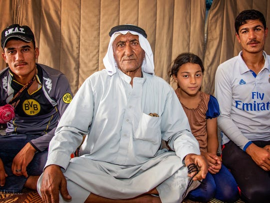 A man named Mahmoud, second from left, from a village