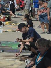 Larry Diaz, center, participates in the Ventura Art