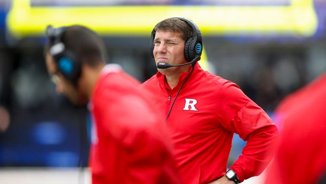Rutgers head coach Chris Ash walks the sidelines against Washington  during the fourth quarter at Husky Stadium.