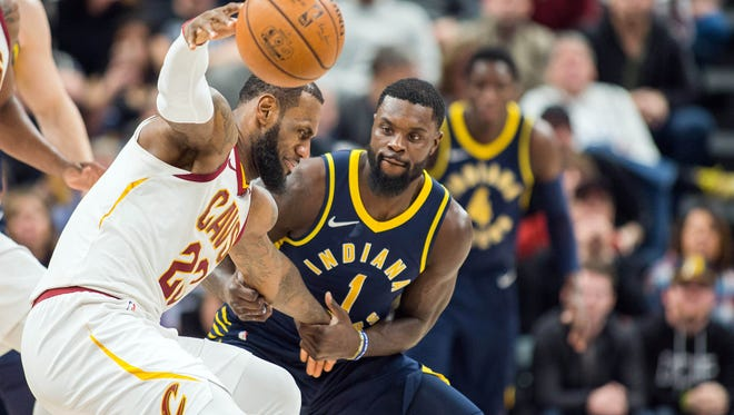 Jan 12, 2018; Indianapolis, IN, USA; Indiana Pacers guard Lance Stephenson (1) forces Cleveland Cavaliers forward LeBron James (23) to loose the ball in the second half at Bankers Life Fieldhouse. Mandatory Credit: Trevor Ruszkowski-USA TODAY Sports